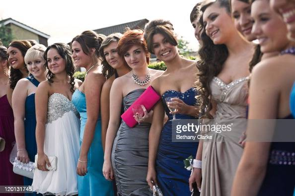Students pose for pictures at a gathering before they travel on a bus to the school prom on July 1 2011 in Newcastle United Kingdom After months of...