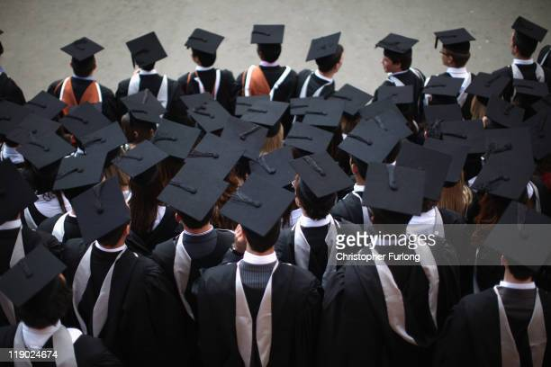 Students pose for their official group photograph at the University of Birmingham as they take part in their degree congregations on July 14 2011 in...