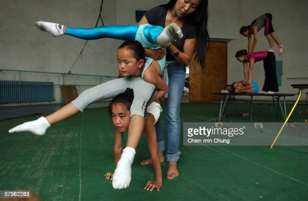 Students practice at the contortionist school in the Mongolian Circus July 18 2005 in Ulaanbaatar Mongolia