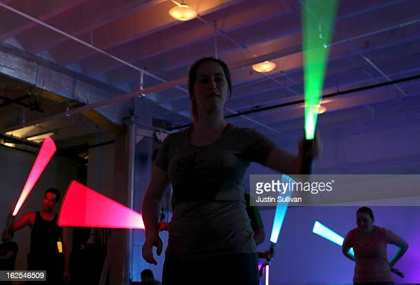 Students practice moves with lightsabers during a Golden Gate Knights class in saber choreography on February 24 2013 in San Francisco California...
