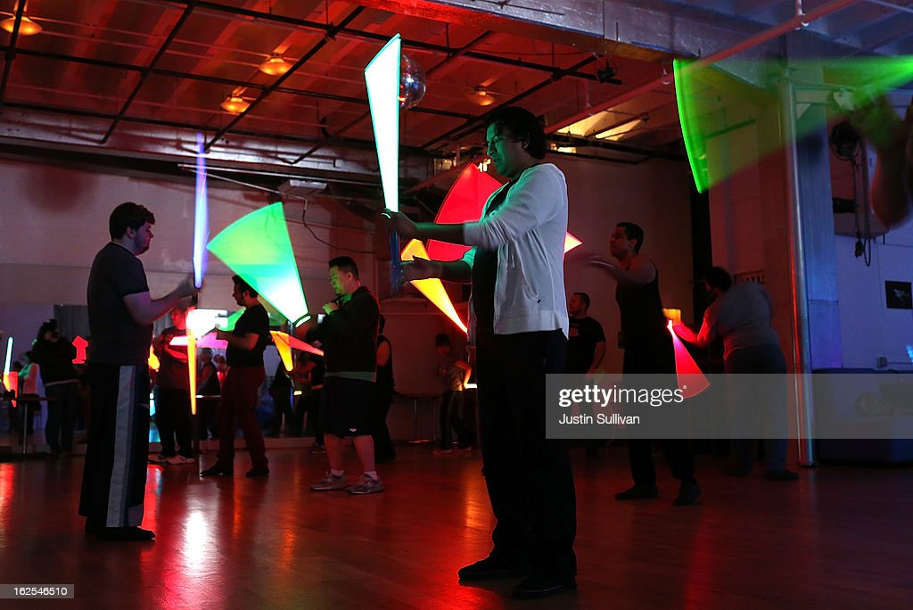 Students practice moves with lightsabers during a Golden Gate Knights class in saber choreography on February 24, 2013 in San Francisco, California. Star Wars fans Alain Bloch and Matthew Carauddo founded the Golden Gate Knights in 2011 to teach classes on how to safely wield a lightsaber and perform choreographed moves. The three hour class costs ten dollars and all equipment is provided.