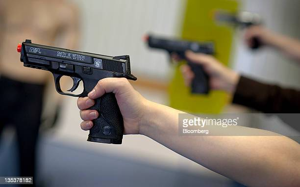 Students practice shooting Smith Wesson Holdings Corp MP 40 Airsoft pistol during an all women class at the Oklahoma Personal Defense Academy in...