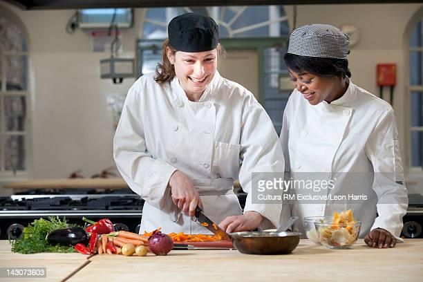 Students practicing in cooking school