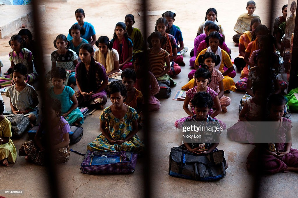 Students pray after classes at the Aarti Home shelter on February 21, 2013 in Kadapa, India. Female infanticide is still prevalent in rural areas of India. The abuse of the dowry tradition has been one of the main reasons for sex-selective abortions and female infanticides in India.