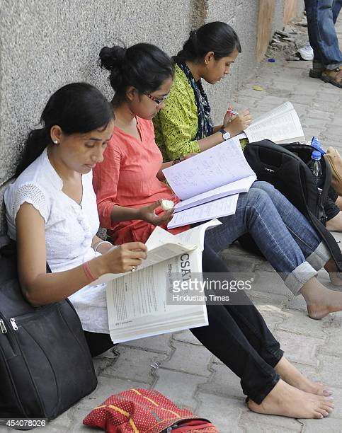 Students preparing for the UPSC civil services preliminary examination in the last minute at their examination center at a school at Gole Market on...