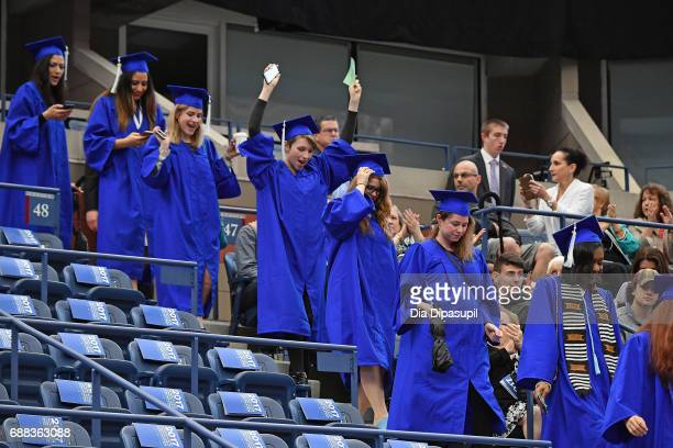 Students process into the stadium during The Fashion Institute of Technology's 2017 Commencement Ceremony at Arthur Ashe Stadium on May 25 2017 in...
