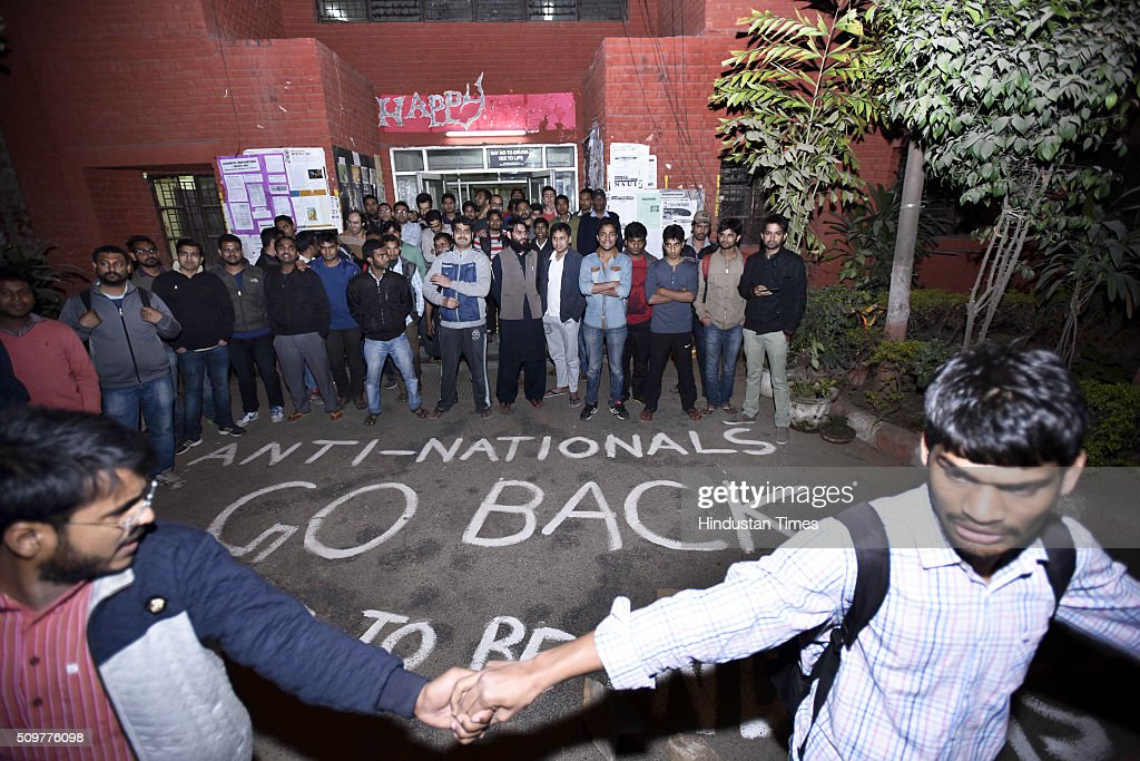 Students protest against the organisers of the event on Afzal Guru where slogans were anti-national slogans were raised at JNU Campus on February 12, 2016 in New Delhi, India. JNU students union president Kanhaiya Kumar was arrested on in connection with a case of sedition and criminal conspiracy over holding of an event at the prestigious institute against hanging of Parliament attack convict Afzal Guru in 2013. A group of students on Tuesday held an event on the JNU campus and allegedly shouted slogans against India.