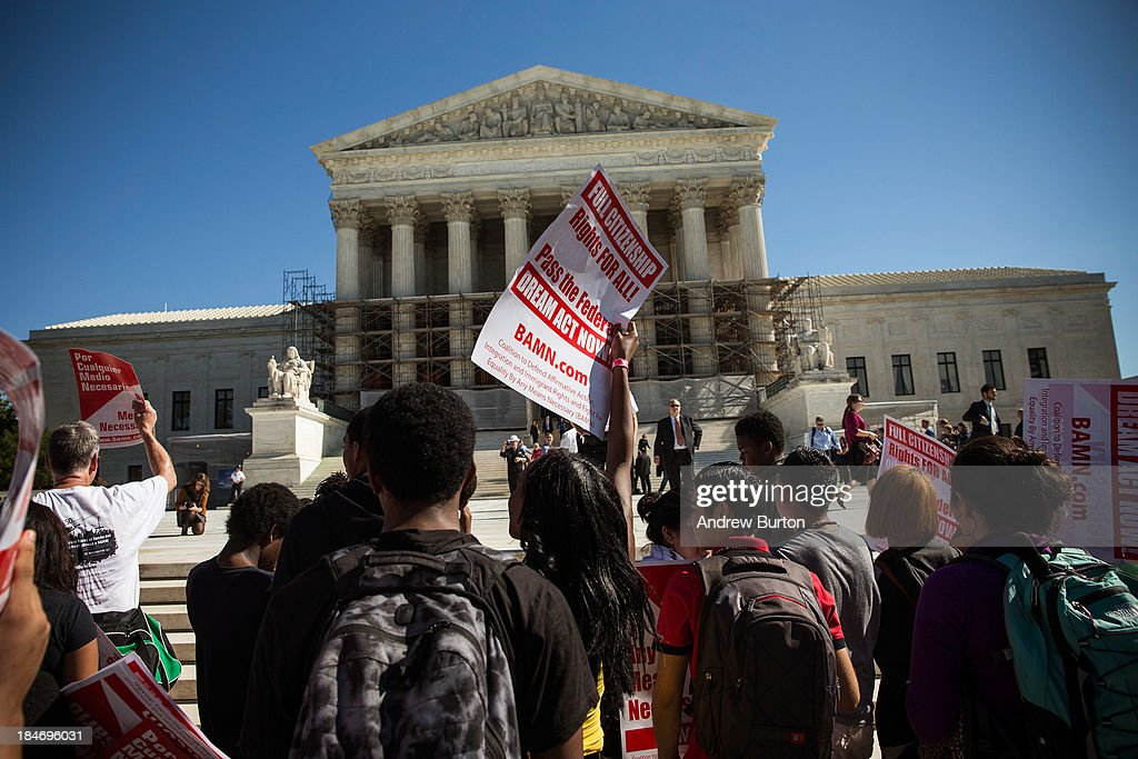 Students protest in support of affirmative action, outside the Supreme Court during the hearing of 'Schuette v. Coalition to Defend Affirmative Action' on October 15, 2013 in Washington, DC. The case revolves around affirmative action and whether or not states have the right to ban schools from using race as a consideration in school admissions.