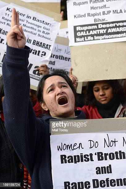 Students protest to condemn the remarks of Asaram Bapu and RSS chief Mohan Bhagwat over the 23 year old gang rape victim at Jantar Mantar in New...
