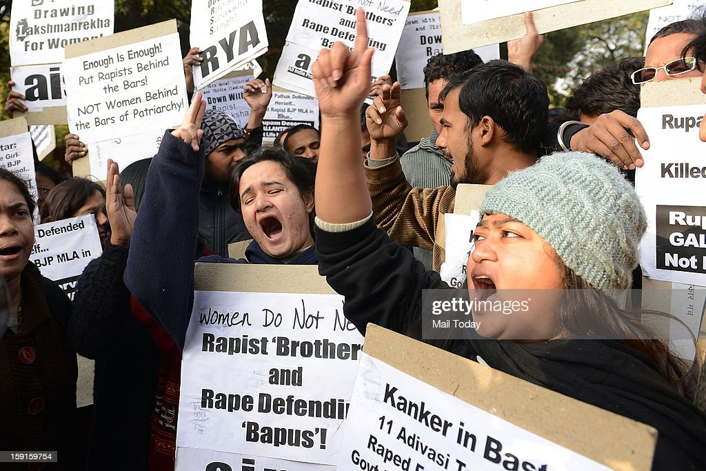 Students protest to condemn the remarks of Asaram Bapu and RSS chief Mohan Bhagwat over the 23 year old gang rape victim at Jantar Mantar in New Delhi on Tuesday.