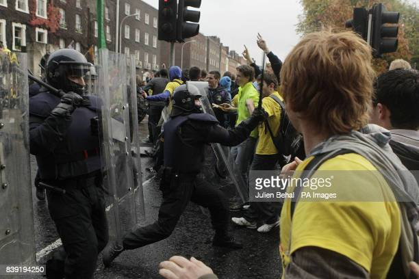 Students protesting against a increase in 3rd level fees clash with riot police as they hold a mass demonstration in Dublin city centre outside the...