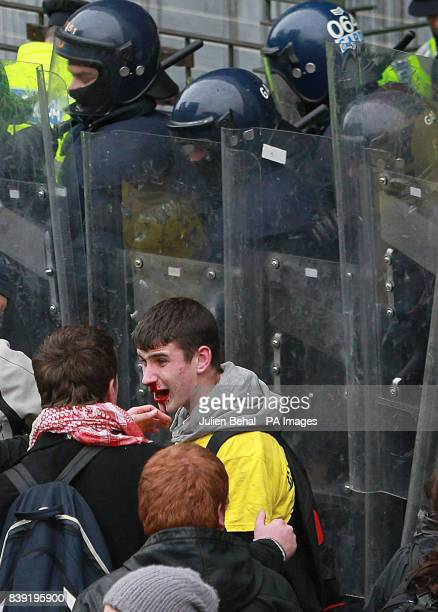 Students protesting against a increase in 3rd level fees clash with police as they hold a mass demonstration in Dublin city centre outside the...
