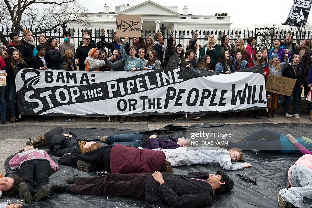 Students protesting against the proposed Keystone XL pipeline chant slogans in front of the White House in Washington,DC on March 2, 2014. tudents from around the country gathered to oppose the tar sands oil pipeline from Canada, which they say is dangerous for the environment. US Secretary of State John Kerry is set to announce in the coming months whether the proposed $5.4 billion oil pipeline serves the national interest and will be constructed following years of confrontation between environmentalists and the oil industry. AFP PHOTO/Nicholas KAMM