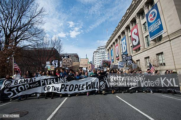 Students protesting against the proposed Keystone XL pipeline march past the US Chamber f Commerce near the White House in WashingtonDC on March 2...