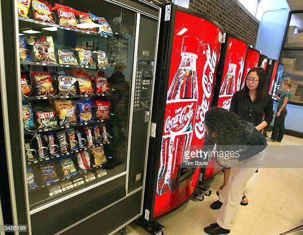 Students purchase soft drinks from vending machines at Jones College Prep High School April 20 2004 in Chicago Illinois The Chicago Public School...