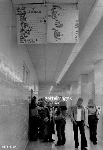 Students queues up at JFK high school cafeteria one student said prices listed on corridor sign were like the old days' Credit Denver Post