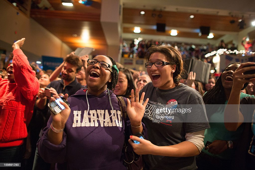 Students react after U.S. President Barack Obama was projected the winner of the presidential election inside the Kennedy Forum at the Harvard University John F. Kennedy School of Government in Cambridge, Massachusetts, U.S., on Tuesday, Nov. 6, 2012. Obama, the post-partisan candidate of hope who became the first black U.S. president, won re-election today by overcoming four years of economic discontent with a mix of political populism and electoral math. Photographer: Scott Eisen/Bloomberg via Getty Images
