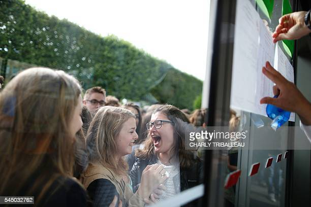 TOPSHOT Students react as they check the results of the baccalaureat exam at Malherbe high school in Caen northwestern France on July 5 2016 / AFP /...