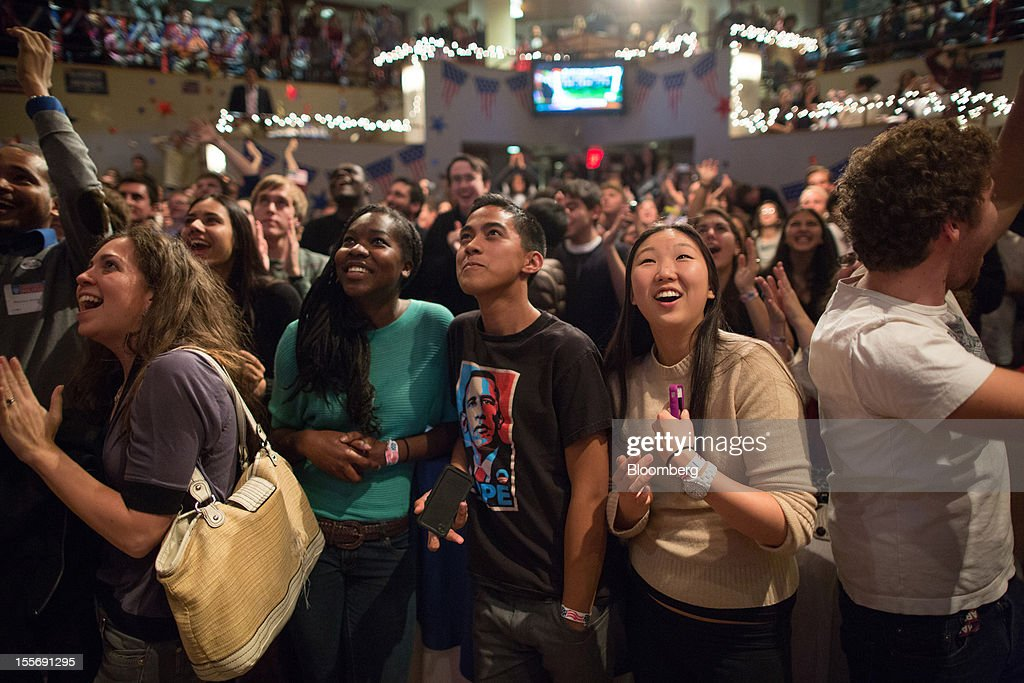 Students react as they watch election returns come in inside the Kennedy Forum at the Harvard University John F. Kennedy School of Government in Cambridge, Massachusetts, U.S., on Tuesday, Nov. 6, 2012. Barack Obama, the post-partisan candidate of hope who became the first black U.S. president, won re-election today by overcoming four years of economic discontent with a mix of political populism and electoral math. Photographer: Scott Eisen/Bloomberg via Getty Images