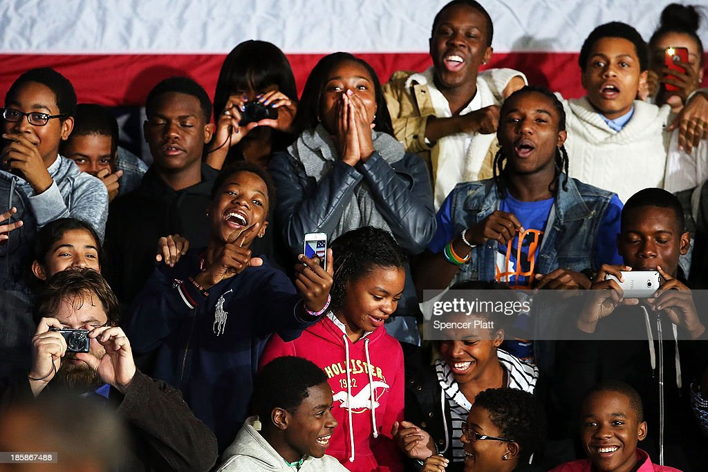 Students react as U.S. President Barack Obama walks onto stage to speak at the Pathways in Technology Early College High School in the Crown Heights section of Brooklyn on October 25, 2013 in New York City. President Obama had mentioned the school in a part of Brooklyn that's struggled with poverty and violence during his State of the Union address in February. While in New York Obama will also attend events to raise money for the Democratic National Committee and Democratic Congressional Campaign Committee.