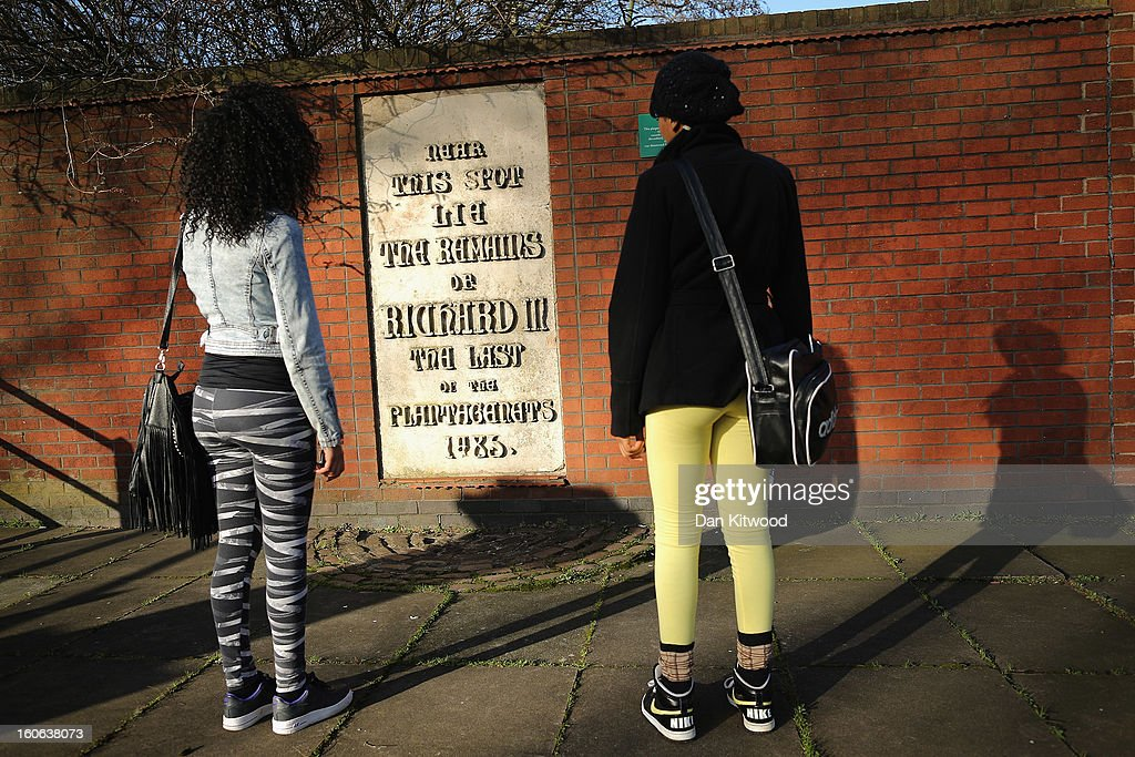 Students read a stone plaque incorrectly claiming to mark the spot where the remains of King Richard III lie near Leicester Catherdral, on February 4, 2013 in Leicester, England. The University of Leicester has been carrying out scientific investigations on remains found in a car park to find out whether they are those of King Richard III since last September, when the skeleton was discovered in the foundations of Greyfriars Church, Leicester. King's Richard III's remains are to be re-interred at Leicester Catherdral.