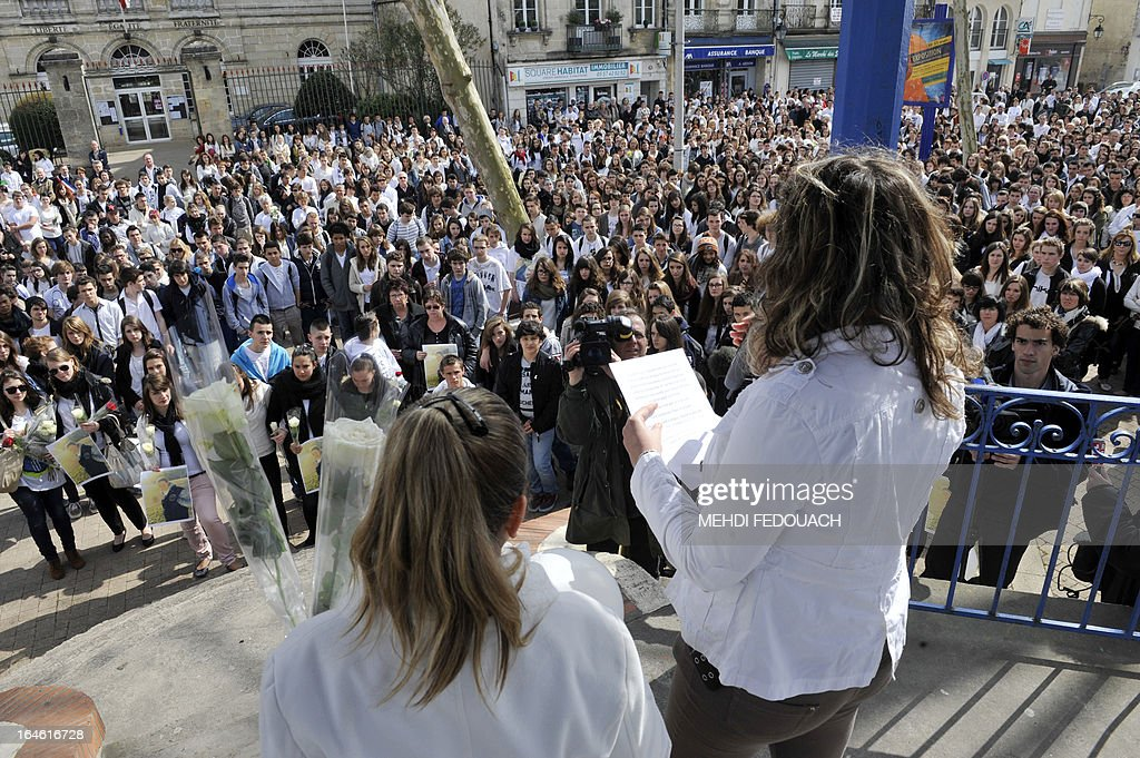 Students read an homage on March 25, 2013 during a ceremony and march in honour of Sylvain, a 15-year-old schoolboy stabbed on March 19 by a 19-year-old comrade in a classroom of the Estuaire college in Blaye, southwestern France.