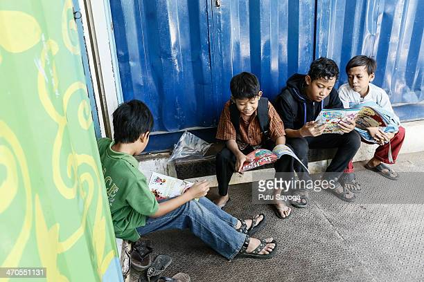 Students read at the front of the class at MASTER school on February 20 2014 in Depok West Java Indonesia The school is known as Masjid Terminal...