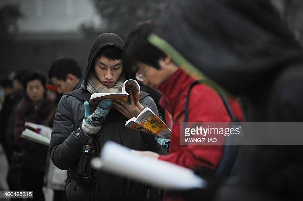 Students read before sitting the National Entrance Examination for Postgraduate at a university in Beijing on January 4 2014 Millions of students...