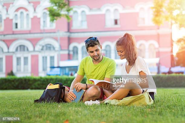 Students reading in the campus