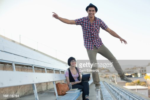 Students relaxing on bleachers : Stock Photo