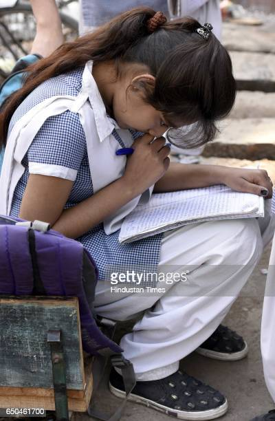 Students revise their lessons before appearing in board exams outside Govt Girls senior secondary school on March 9 2017 in New Delhi India The...