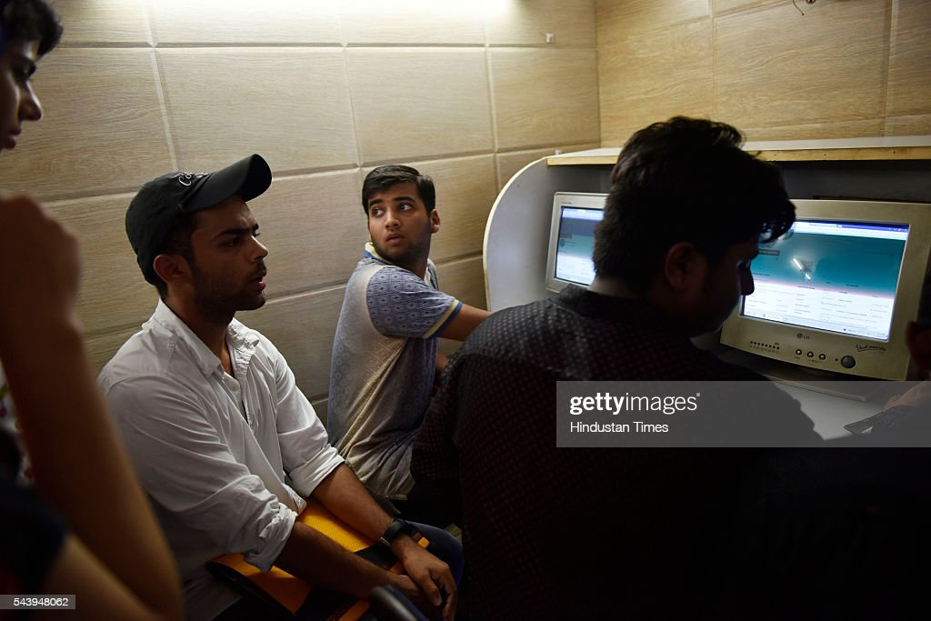 Students rush to cyber café as Delhi University website is overwhelmed with applicants and is unable to handle the load. As a result few students are reaching the colleges for admission, on June 30, 2016 in New Delhi, India.