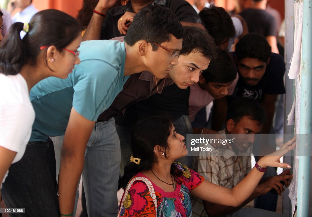 Students scan the second cut-off list at Kirori Mal College in New Delhi on June 26, 2010.