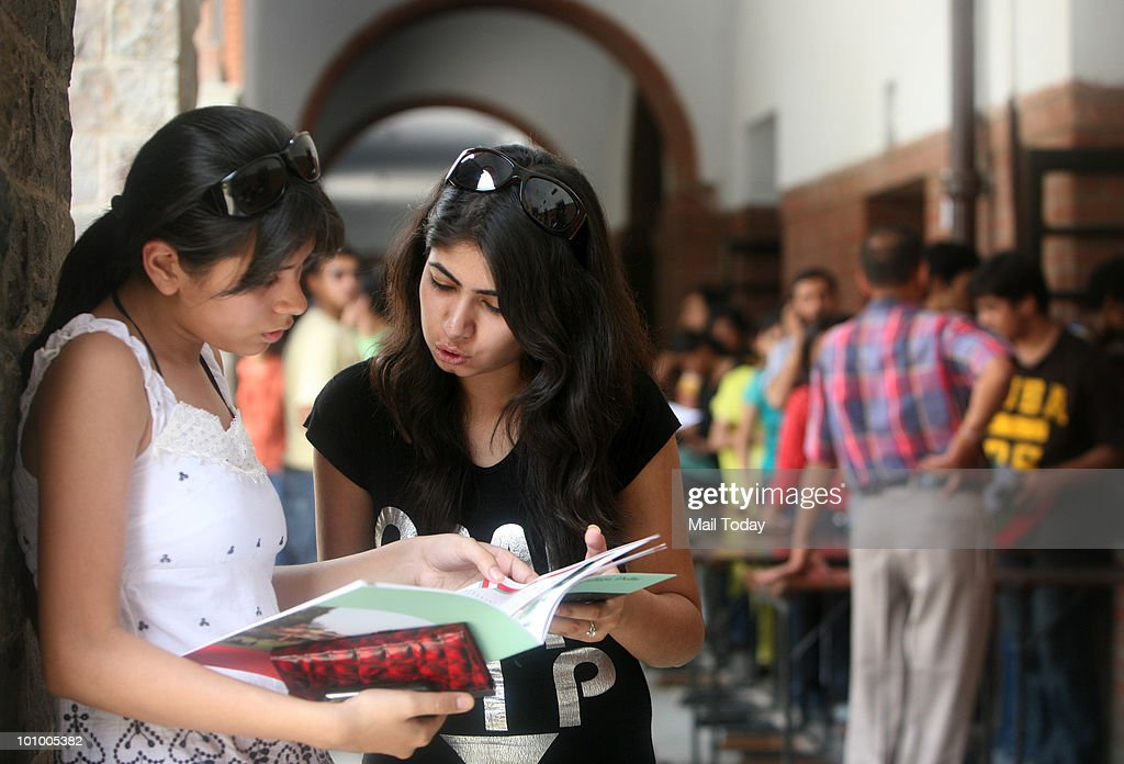 Students seek information regarding admission forms at a Delhi University college on May 26, 2010.