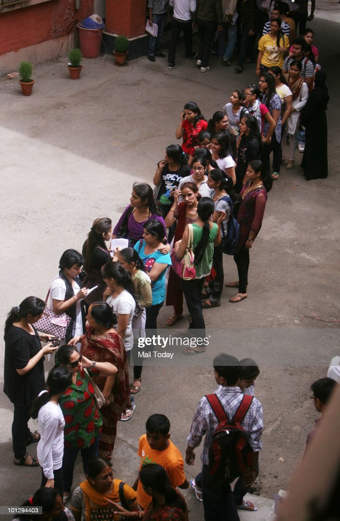 Students seeking admission in degree courses collect the admission forms at a Delhi University on Friday, May 28, 2010.