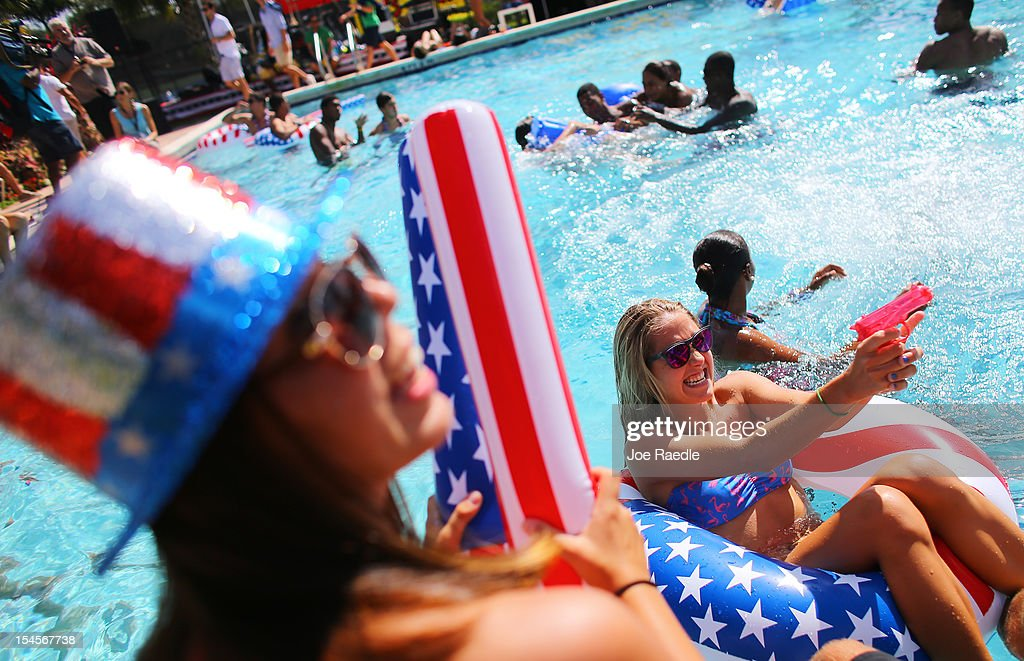 Students Shannon Anderson and Megan Rodwell play in the campus pool prior to the debate between US President Barack Obama and Republican presidential...
