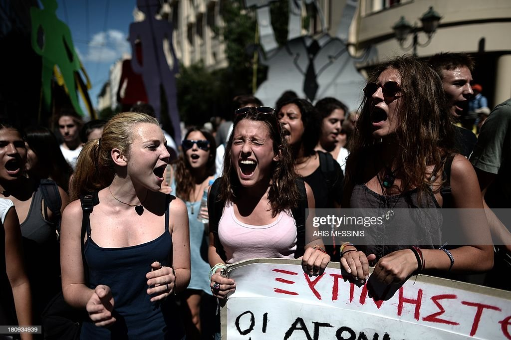 Students shout slogans during a demonstration in central Athens on September 18, 2013. As part of the controversial redeployment plan in the country reeling from six years of recession, civil servants have to accept new posts or spend eight months on reduced salaries as alternative posts are found, with the risk of losing their jobs altogether.