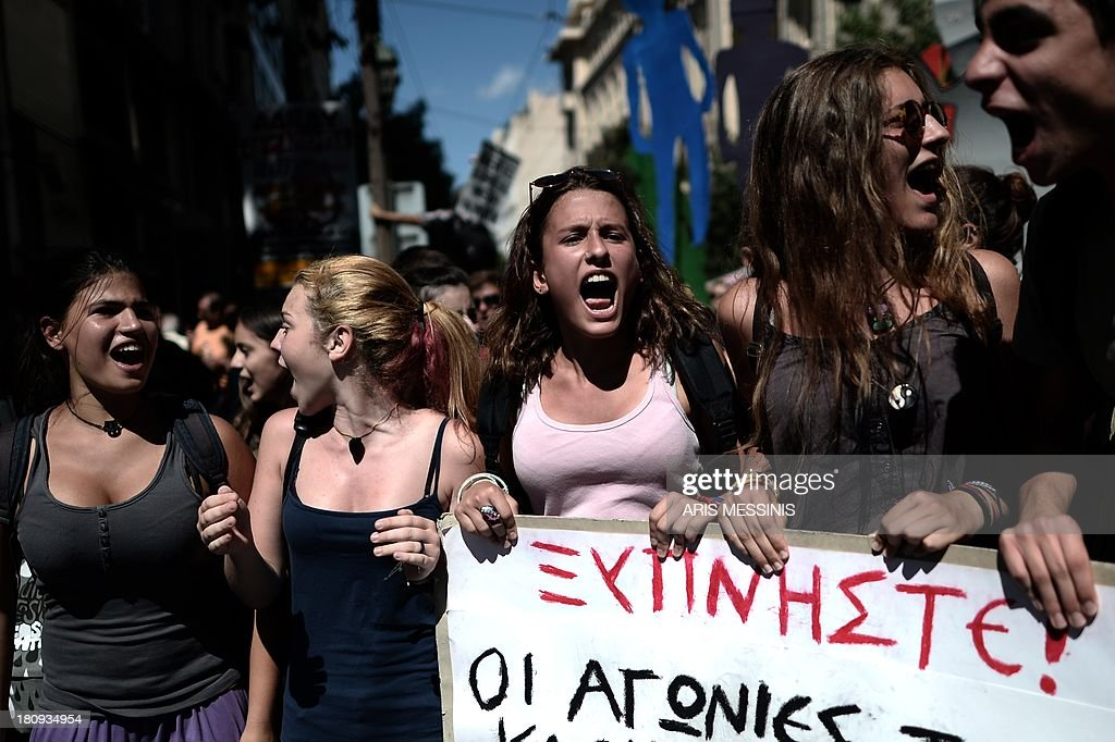 Students shout slogans during a demonstration in central Athens on September 18, 2013. As part of the controversial redeployment plan in the country reeling from six years of recession, civil servants have to accept new posts or spend eight months on reduced salaries as alternative posts are found, with the risk of losing their jobs altogether. The banner reads 'Wake up, the concerns of our teachers are also ours.' AFP PHOTO / ARIS MESSINIS
