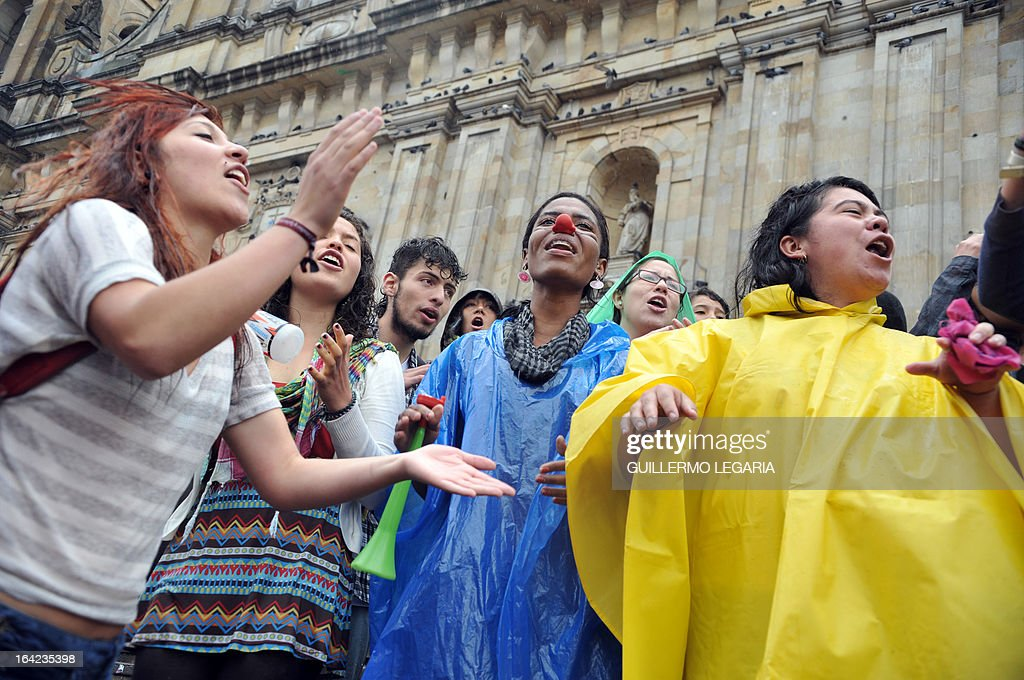 Students shout slogans during a protest in Bogota, Colombia on March 21, 2013, demanding a better and free education and an alternative university reform. AFP PHOTO/Guillermo Legaria