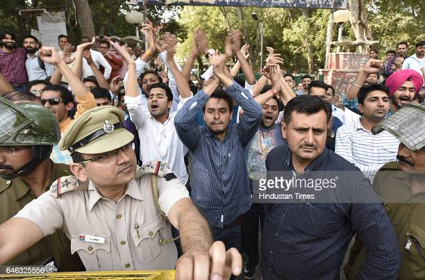ABVP students shout slogans during the AISA JNUTA and Delhi University Students' protest march against ABVP wing after 22nd February issue from...
