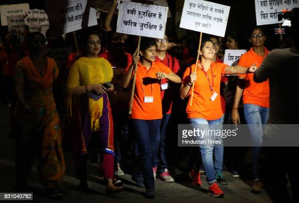 Students shout slogans 'Why most decent boys stay mum in face of few jackals' during the 'Meri Raat Meri Sadak' campaign in which thousands of girls...