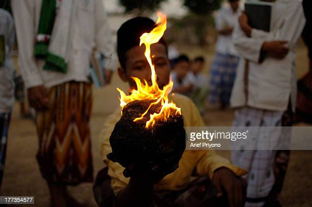 Students show fireproof ability in the game 'Fire Football' at an Islamic boarding school called Lirboyo Fire Football is a soccer game using a...
