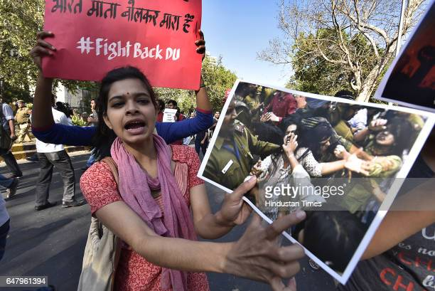 Students showing HT NewsPaper's pictures of the incidents of 22 feb in DU During the citizens protest march for Justice and Save Delhi University end...