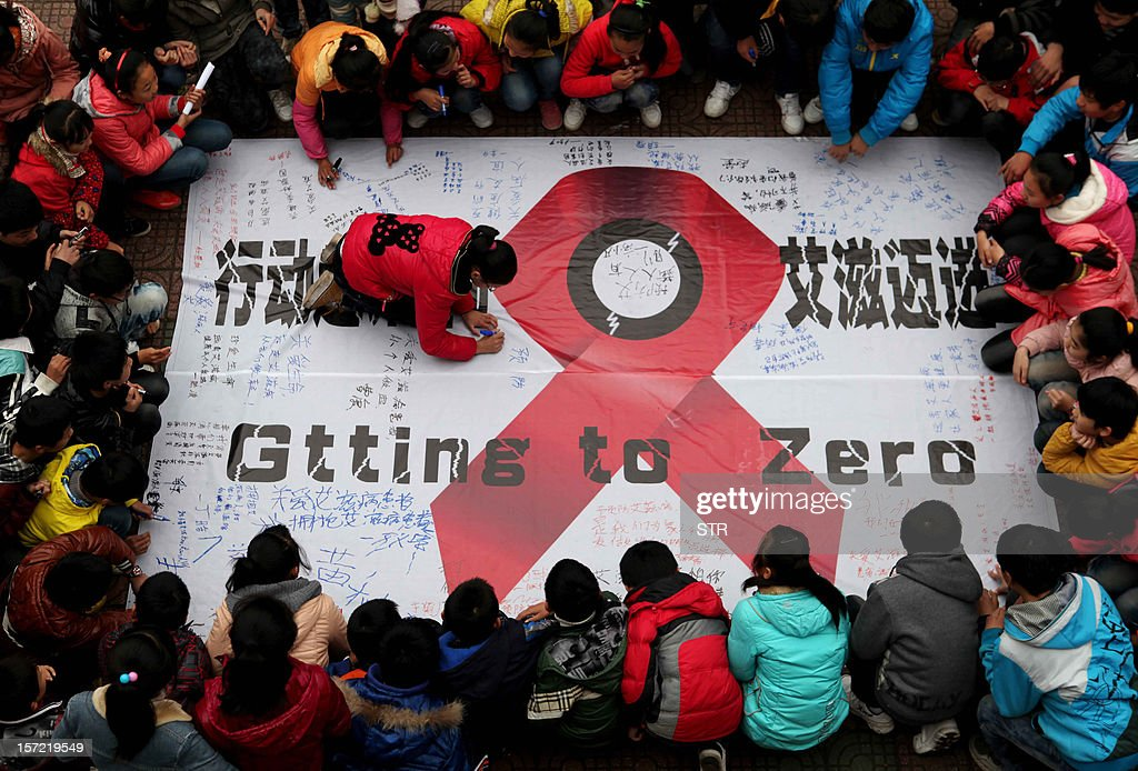 Students sign their names on an anti-AIDS banner during a AIDS day event at a school in Hanshan, central China's Anhui province on November 30, one day before the 2012 AIDS day. Chinese AIDS activists on November 29 accused the Communist Party's new number two Li Keqiang of hypocrisy after he called for more non-government efforts to fight the disease. CHINA