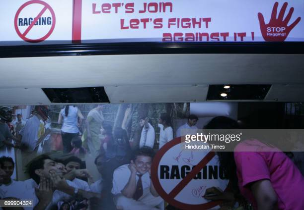 Students signing at campaign of Bus Aur Nahin speak up against ragging in colleges Anti Ragging Bus will cover major colleges in Mumbai