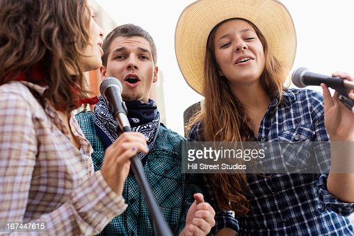 Students singing together : Stock Photo
