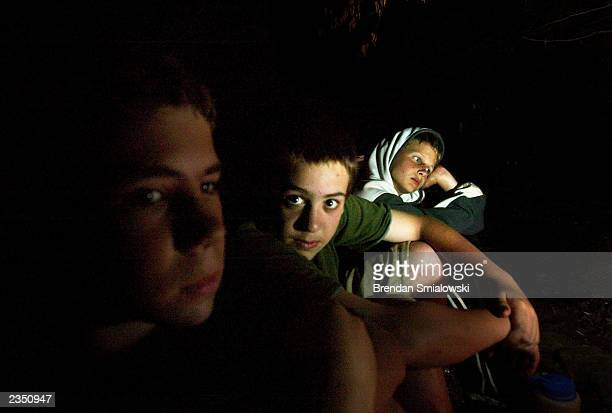 Students sit by the fire while camping out at the Center for Attention and Related Disorders camp at the Great Hollow Wilderness School July 30 2003...
