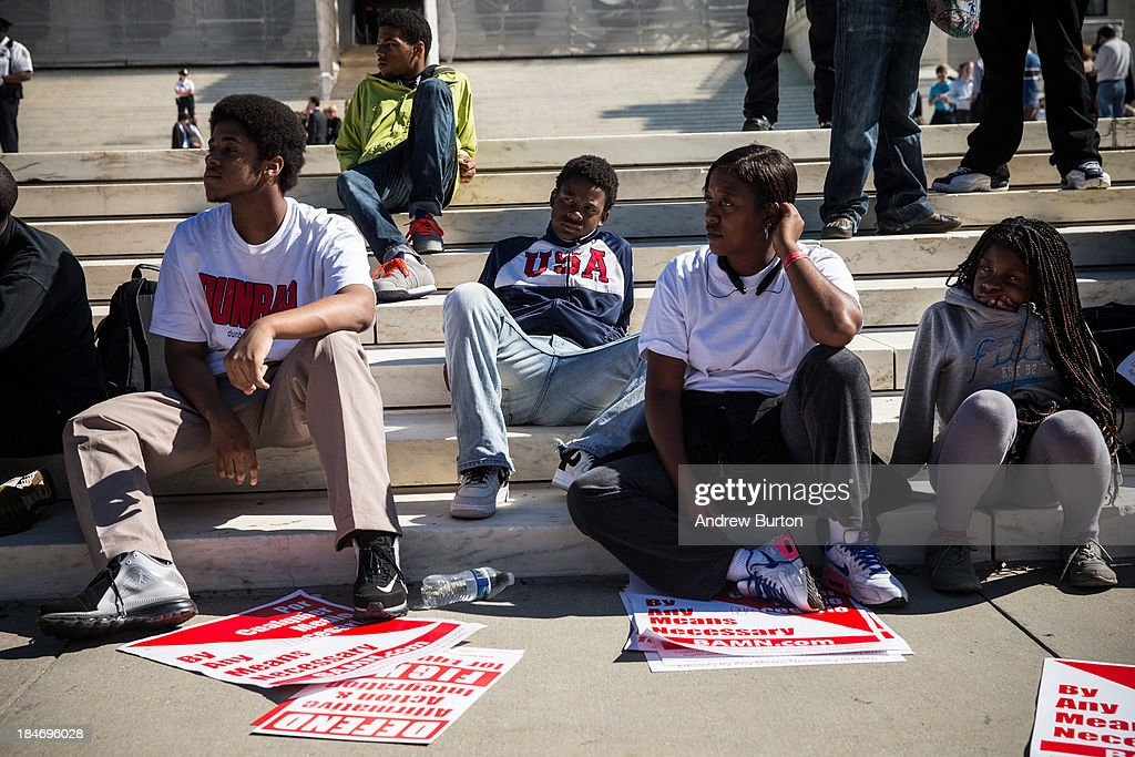 Students sit during a protest in support of affirmative action, outside the Supreme Court during the hearing of 'Schuette v. Coalition to Defend Affirmative Action' on October 15, 2013 in Washington, DC. The case revolves around affirmative action and whether or not states have the right to ban schools from using race as a consideration in school admissions.