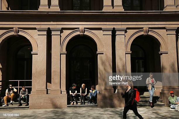 Students sit in front of Cooper Union for the Advancement of Science and Art one of the last tuitionfree colleges in the country on April 24 2013 in...