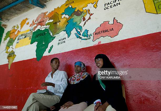 Students sit on April 17 2012 in a school in the Somaliland capital Hargeisa which was renamed after a former student Fadumo Bihi who lost both her...